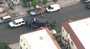 A man wounded in a shootout with deputies surrendered after an hour-long standoff in South L.A. on Friday, March 13, 2015. (Credit: KTLA)